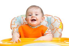 Happy baby child waiting for food Royalty Free Stock Photos