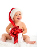 Happy baby in a Christmas hat with a gift isolated. On white background Royalty Free Stock Photography