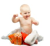 Happy baby with christmas silver tinsel Royalty Free Stock Images