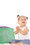 Happy baby clapping with ABC Stock Photography