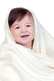 Happy baby covered with a towel Royalty Free Stock Images
