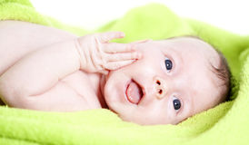 Happy Baby Covered With Green Towel Stock Photography