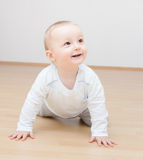 Happy baby crawling Stock Photos
