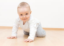 Happy baby crawling Stock Image