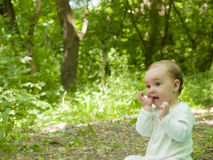 Happy baby crawling in the Park. Stock Photography