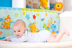 Happy baby on crib Stock Photo