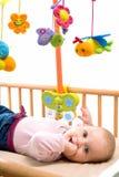 Happy baby on crib Stock Photography