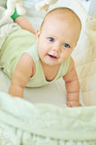 Happy baby in crib Royalty Free Stock Photography