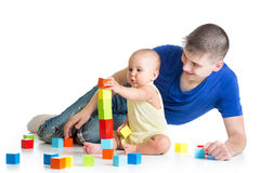 Happy baby and dad play together Stock Photo