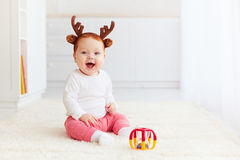 Happy baby deer playing with toy at home Royalty Free Stock Photo