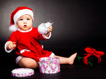 Happy baby dressed as Santa Stock Image