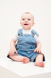 Happy baby in dungarees Royalty Free Stock Photos