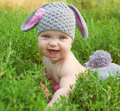 Happy baby easter bunny in green grass. Stock Photos