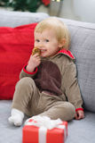 Happy baby eating Christmas cookie Royalty Free Stock Photo
