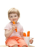 Happy baby eating fresh carrot Royalty Free Stock Image