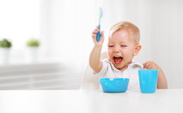Happy baby eating himself Stock Images