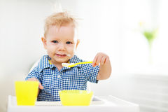 Happy baby eating himself Royalty Free Stock Photography