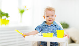 Happy baby eating himself Royalty Free Stock Photos