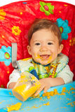 Happy baby eating puree Stock Photography