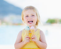 Happy baby eating two ice cream Stock Photography