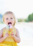 Happy baby eating two ice cream horns Royalty Free Stock Photo