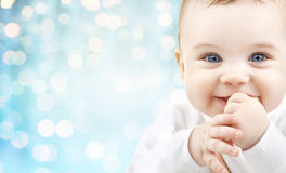 Happy baby face over blue holidays lights Royalty Free Stock Photography