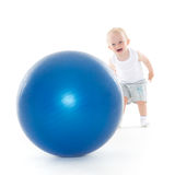 Happy baby with fitness ball. Stock Photo