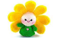 Happy baby flower. Handmade crochet doll on white background stock photography