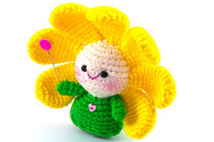 Happy baby flower. Handmade crochet doll on white background royalty free stock image