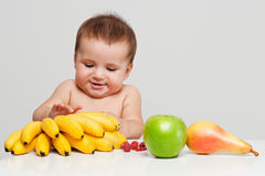 Happy baby with fruits Stock Images