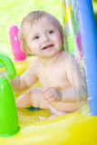 Happy baby in garden Royalty Free Stock Photo