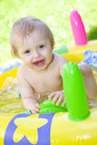 Happy baby in garden Stock Image