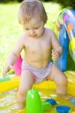 Happy baby in garden Stock Photos
