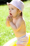 Happy baby in garden royalty free stock images
