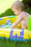 Happy baby in garden royalty free stock photos
