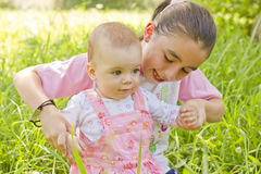 Happy baby girl. Help to walking a baby girl stock images