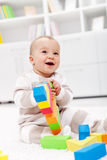 Happy baby girl. Playing on the floor at home Royalty Free Stock Photos