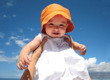 Happy Baby Girl. Mom holding baby girl at the beach Stock Images