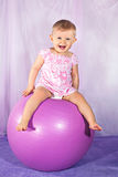 Happy baby girl on ball Stock Photos