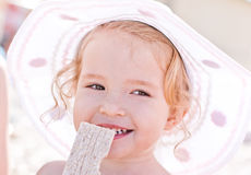 Happy baby girl on the beach Royalty Free Stock Image