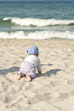 Happy baby girl on beach. Royalty Free Stock Image