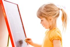 Happy baby girl beautiful painting on the easel on a white background stock image