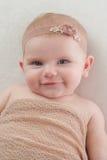 Happy Baby Girl with Beige Flower Headband Stock Photos