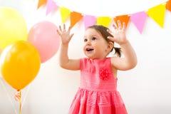 Happy baby girl on birthday party royalty free stock photos