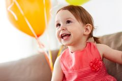 Happy baby girl on birthday party at home Stock Photo