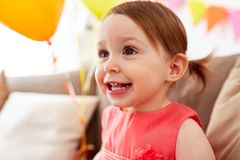 Happy baby girl on birthday party at home Royalty Free Stock Images