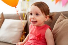 Happy baby girl on birthday party at home Royalty Free Stock Photo