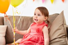 Happy baby girl on birthday party at home Stock Images