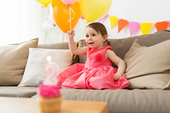 Happy baby girl on birthday party at home Royalty Free Stock Photography