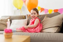 Happy baby girl on birthday party at home Stock Photography